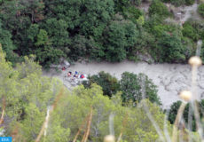 epa06960779 A general aerial view showing rescuers at work in the Gorge of Raganello where the flash flood claimed eight victims, in Civita, southern Italy, 20 August 2018. According to the national civil protection organization, at least eight people died in the waves of the Raganello in Civita stream. Another 18 people have been identified while the recovery operations are continued by firefighters and mountain rescue service.  EPA-EFE/FRANCESCO CAPITANEO