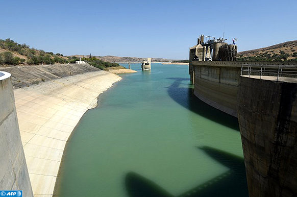 A photo taken on August 21, 2016 shows the Sidi Salem dam near Testour, in Tunisia's north-west Beja region, which has particularly low water levels due to a 30 percent drop in rainfall in the North African country this year. Water-cuts, dry dams and withering vegetation: Tunisia has faced a difficult summer due to a lack of rainfall which has reinforced social tensions in several disadvantaged regions. / AFP PHOTO / FETHI BELAID / TO GO WITH AFP STORY BY MOUNIR SOUISSI