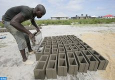 epa06944017 Amstrong Biah produces bricks, from a mixture of cement and sand at a construction site in Ben's Town, Marshall, Margibi County, Liberia, 11 August 2018. Many youths, who  dropped out of high school or have no formal education, move to urban areas for low paid  jobs at construction sites, as means of livelihood.  EPA-EFE/AHMED JALLANZO
