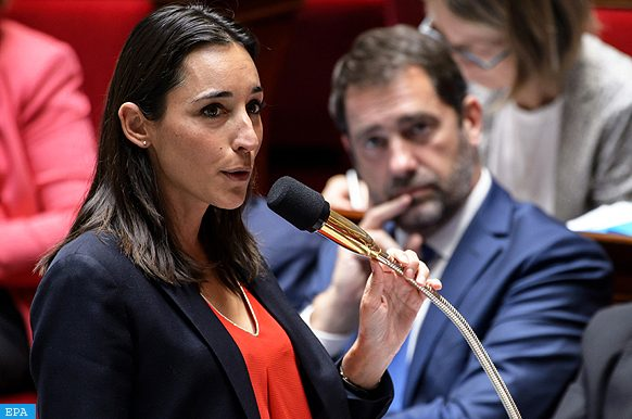 epa06133686 French junior Minister in charge of ecological transition Brune Poirson (L) speaks during the weekly Government Question time at the French National Assembly in Paris, France, 09 August 2017.  EPA/CHRISTOPHE PETIT TESSON