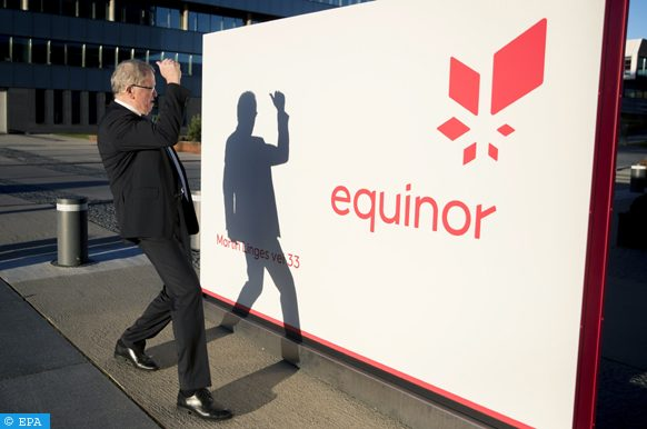 epa07118223 Eldar Saetre, the CEO of Norwegian natural gas and oil company Equinor, looks at his own shadow cast on an equinor sign after the presentation of the company's Q3 results, outside their headquarters in Fornebu, Norway, 25 October 2018.  EPA-EFE/VIDAR RUUD NORWAY OUT
